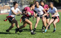 """Sophomore rusher Darcy Munoz, senior linebackers Fanny Lee (12) and Carmen Chen (18) work together to """"tackle"""" a Mustang."""