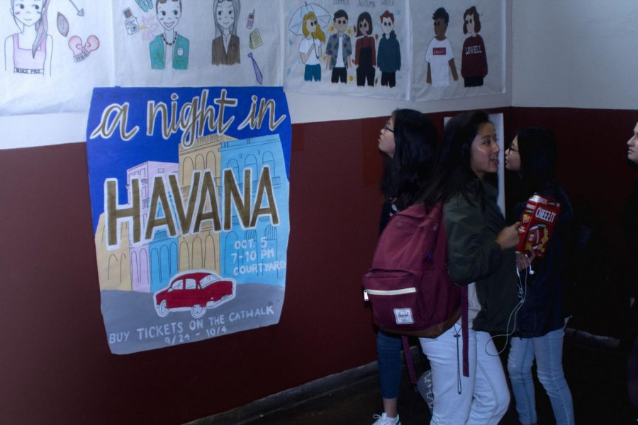 Students observe the A Night in Havana poster.