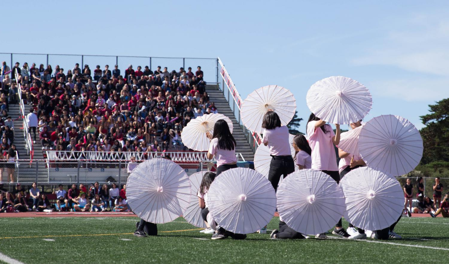 Class+of+2021+opens+up+their+parasols+as+part+of+their+routine.