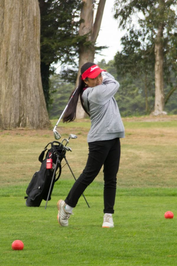 Senior Stephanie Sunga swings the club.