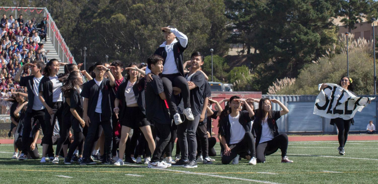 The+class+of+2019+senior+dance+committee+performs+in+their+final+fall+rally.
