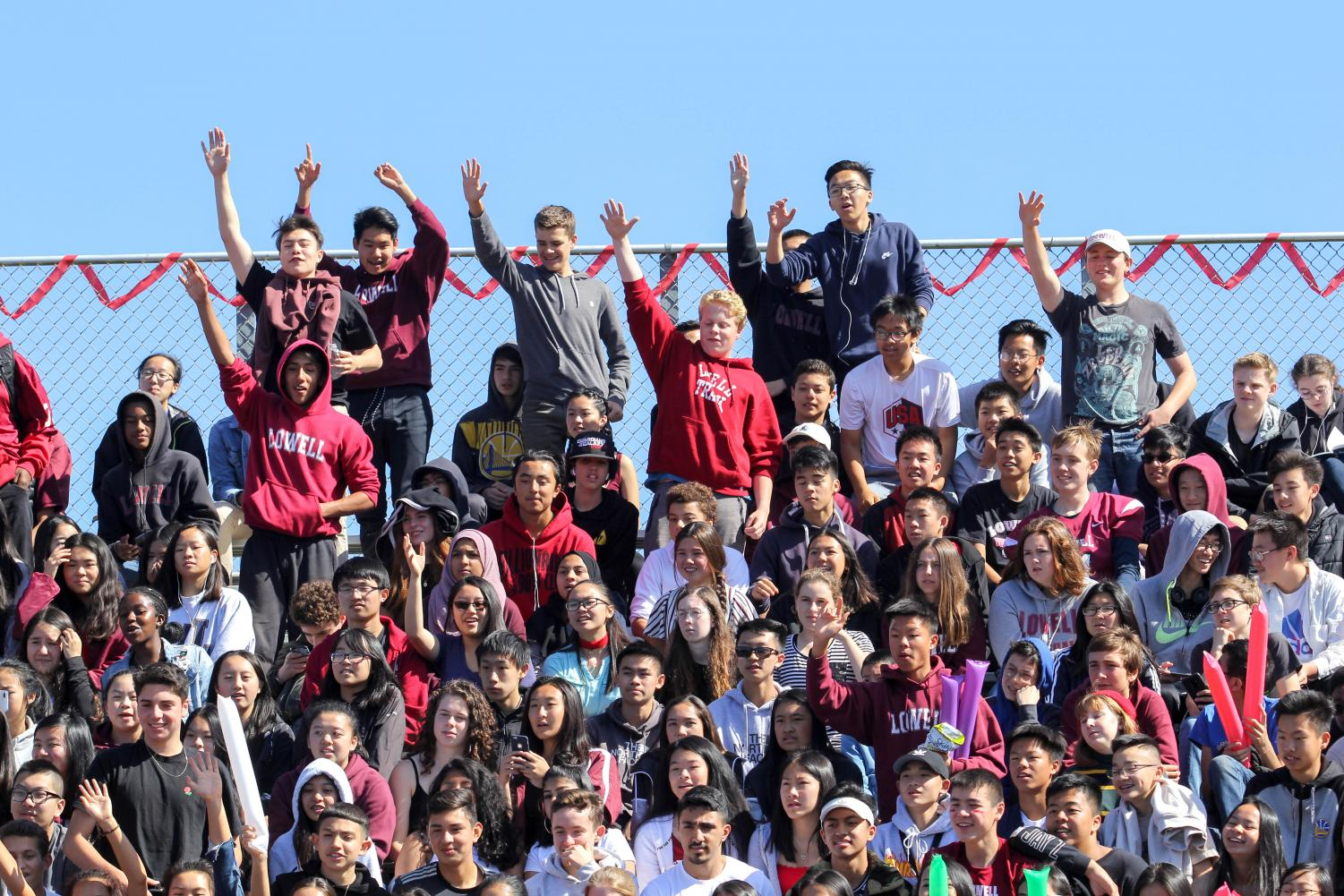 Sophomores+in+the+class+of+2021+wave+their+hands+in+hopes+of+getting+a+free+t-shirt.