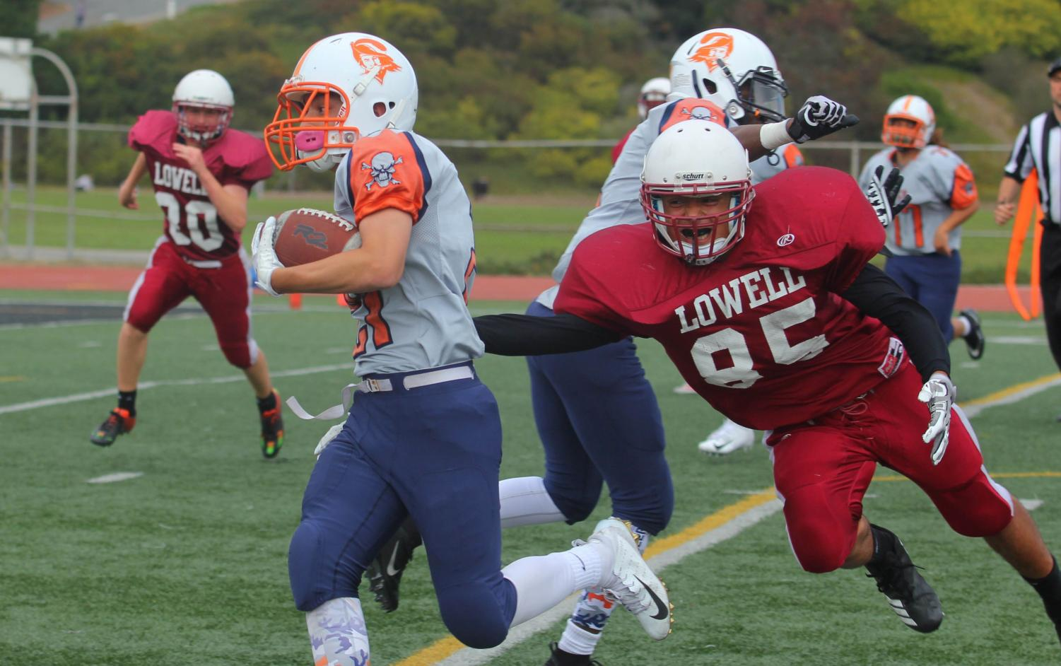 Sophomore running back and middle linebacker Anthony Serrano attempts to tackle his opponent.