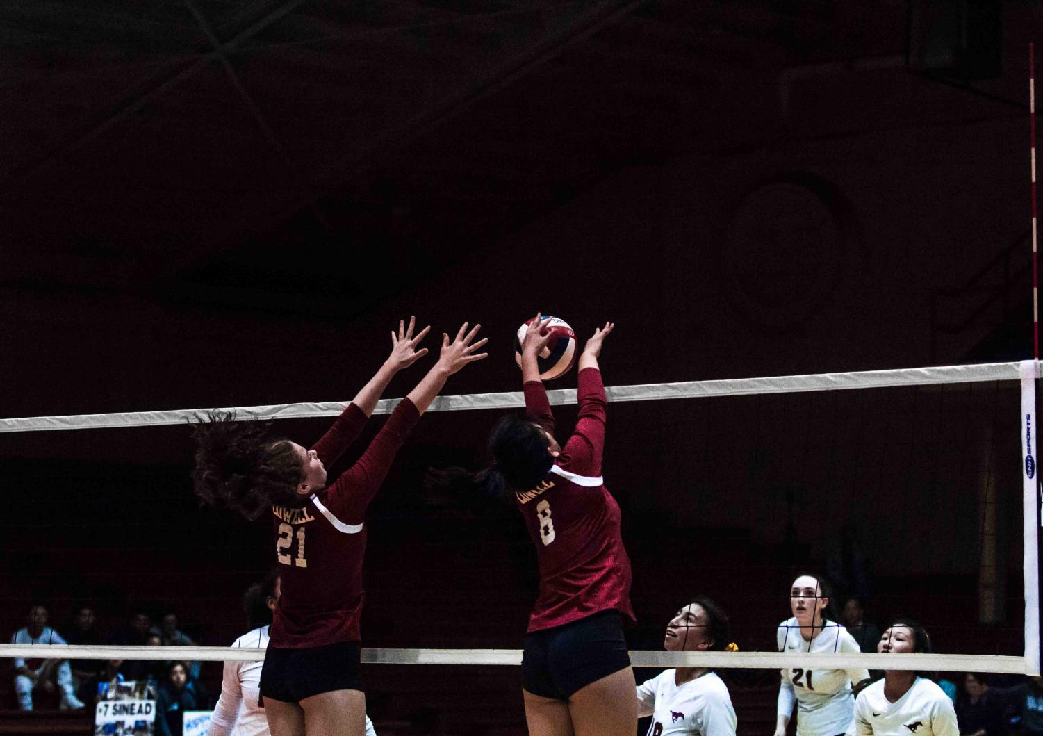Sophomore middle blocker Kenedi Edmunds (left) and senior right-side hitter Betsy Li (right) put up a solid, well-formed block during the AAA Girls Volleyball Championship on Nov. 2 at Kezar,