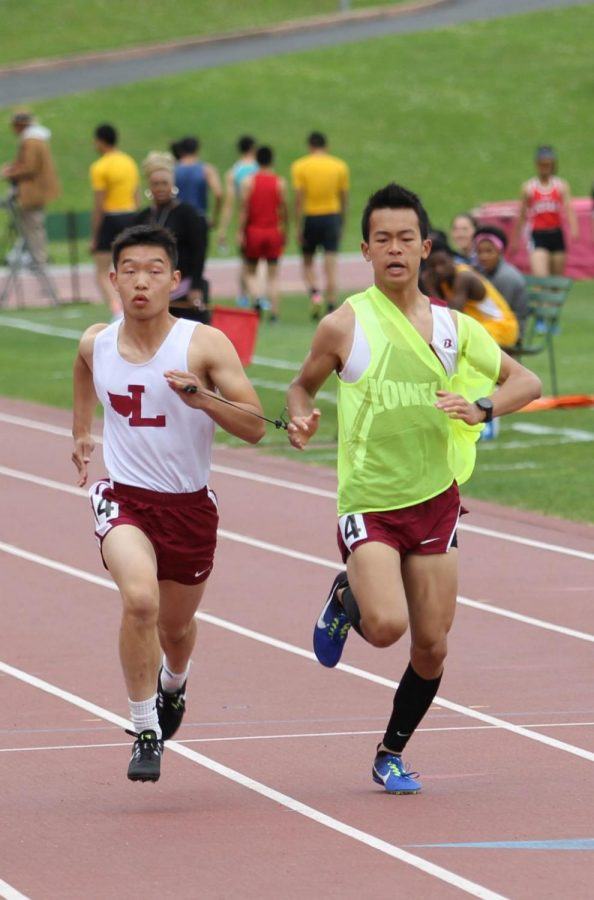 """""""Wait, wait, you're almost done, go go go,"""" Raymond Huang, Fung's running guide and an alum of the Class of 18, says to Fung during the championship."""
