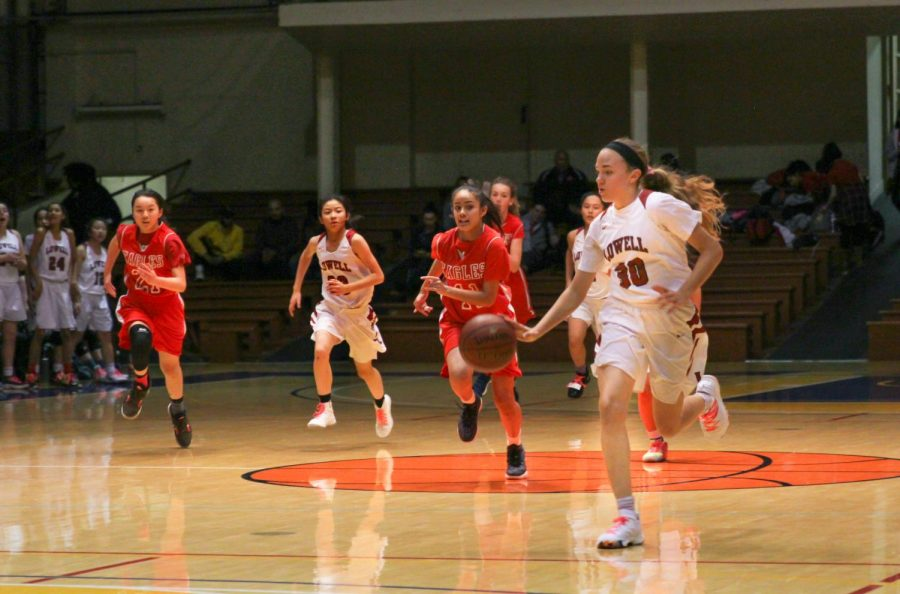 Freshman point guard Elle Ladine dribbles the ball down the court.