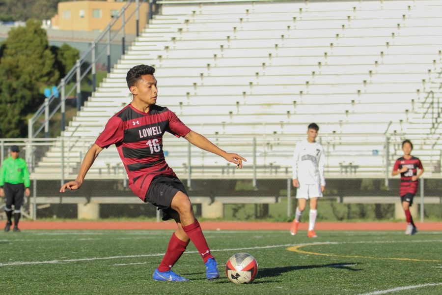 Senior co-captain defender Pablo Herrarte dribbles the ball, getting ready to pass it to a teammate.