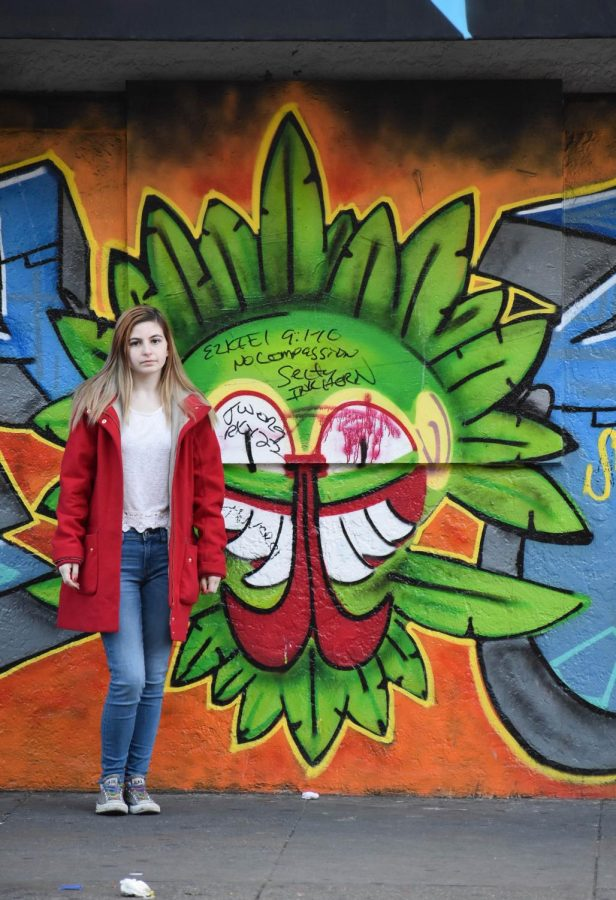 Kerr-Stein stands in front of one of the many murals in the Mission District.
