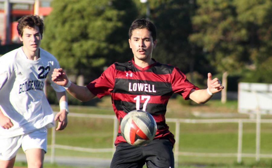 Senior midfielder Luis Fonseca keeps his eyes on the ball.