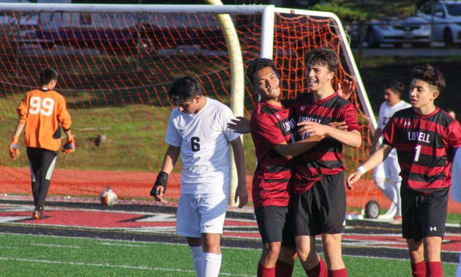 Senior defender Pablo Herrarte congratulates his teammate, senior midfielder Eric Pearce, after he scored.