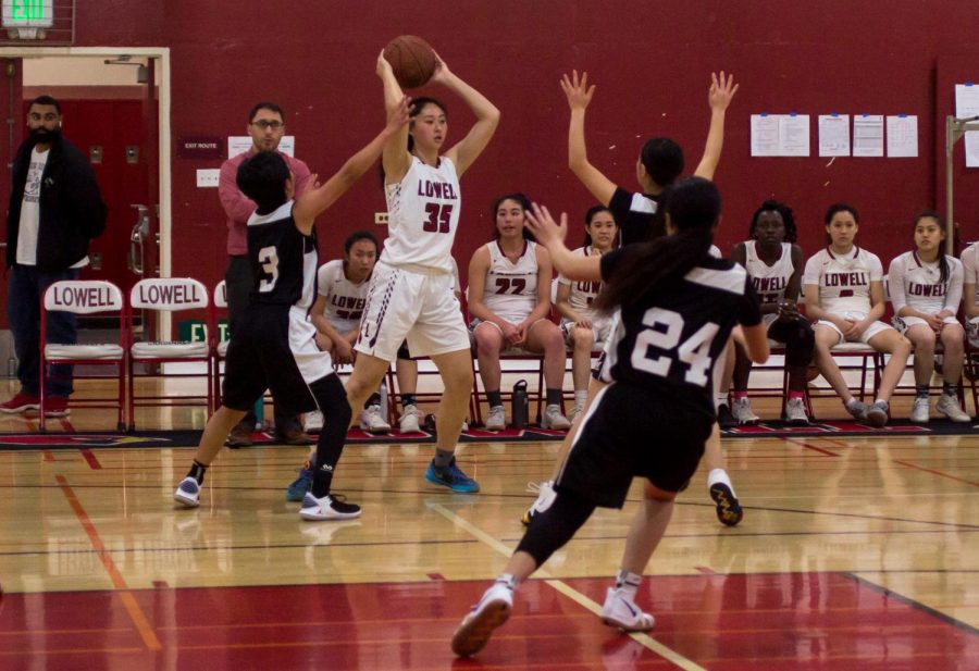 Blocked by the Burton Pumas, senior forward CJ Kung seeks for a chance to pass the ball to her teammates during the game on Feb. 7 at home.