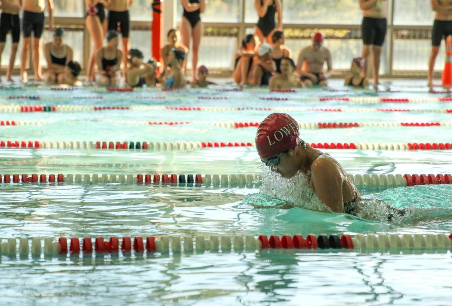 Junior varsity swimmer Maddie Chew swims the breaststoke.
