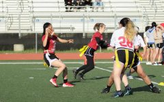 Senior quarterback and co-captain Susan Wong scans the field for an open receiver.