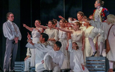 The cast points to Sweeney Todd, played by  Junior Ariel Anderson, after he insults Pirelli's Miracle Elixir.