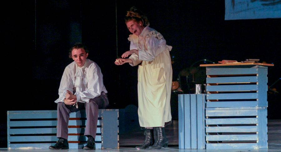 Junior Ariel Anderson, as Sweeney Todd, listens to puns on human meat by Bel Mehaffy, playing Mrs. Lovett.