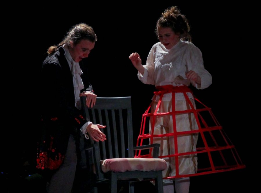 Junior Ariel Anderson, as Sweeney Todd, and senior Bel Mehaffy, as Mrs. Lovett,  marvel over Todds new barber chair.