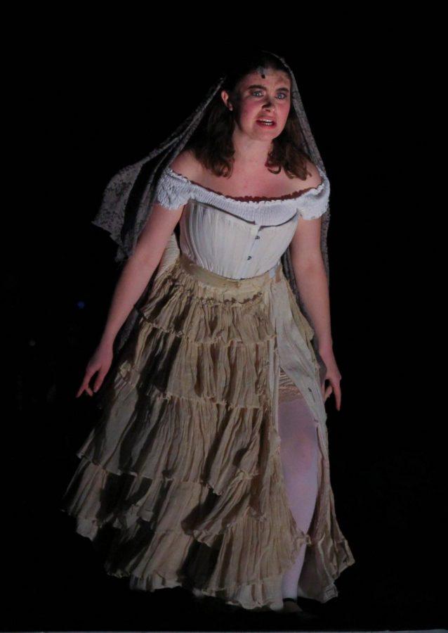 The Beggar Woman (junior Emma Greene) warns the world of danger.