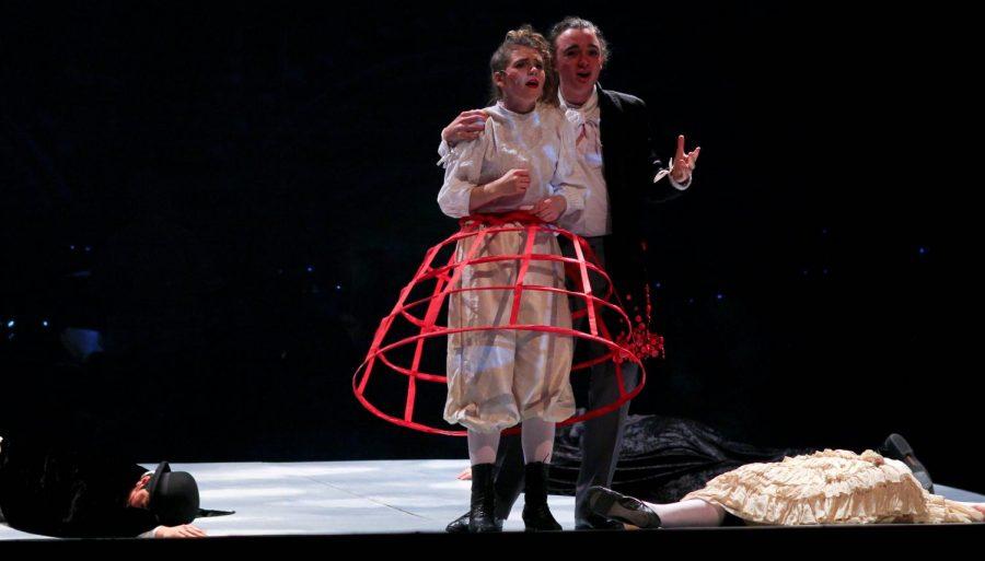 Junior Ariel Anderson, as Sweeney Todd, pretends to forgive senior Bel Mehaffy, playing Mrs, Lovett, before murdering her.