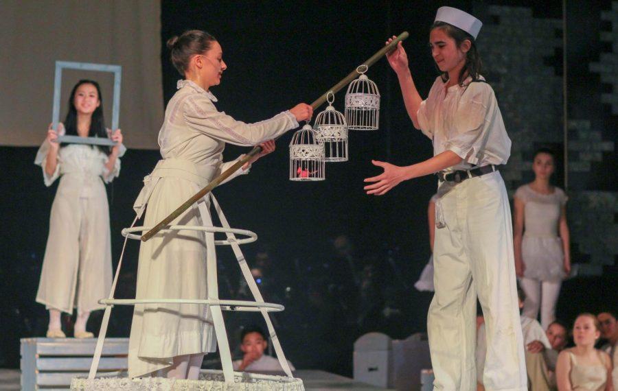 Sophomore Marlo Perez, as Anthony, buys a bird from senior Nola Rettenmaier, as the bird seller, for Johanna.