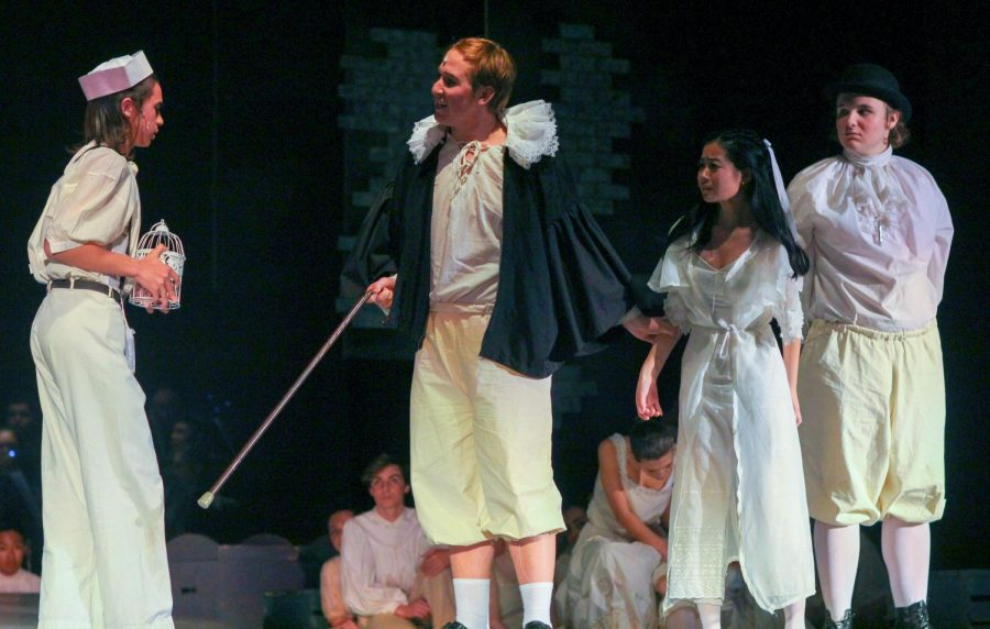 Senior Joseph Guenther, as Judge Turpin, confronts sophomore Marlo Perez, as Anthony, for his brief interaction with his adopted daughter, Johanna, played by junior Madison Chan.