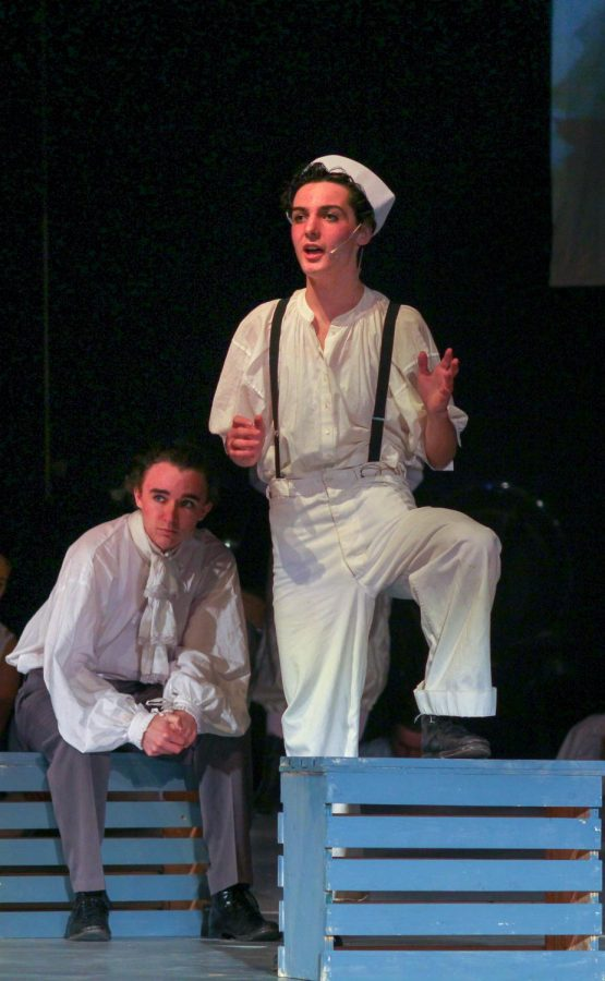 Sophomore Pietro Juvara, as Anthony Hope, helps junior Ariel Anderson, as Sweeney Todd, sail to London.