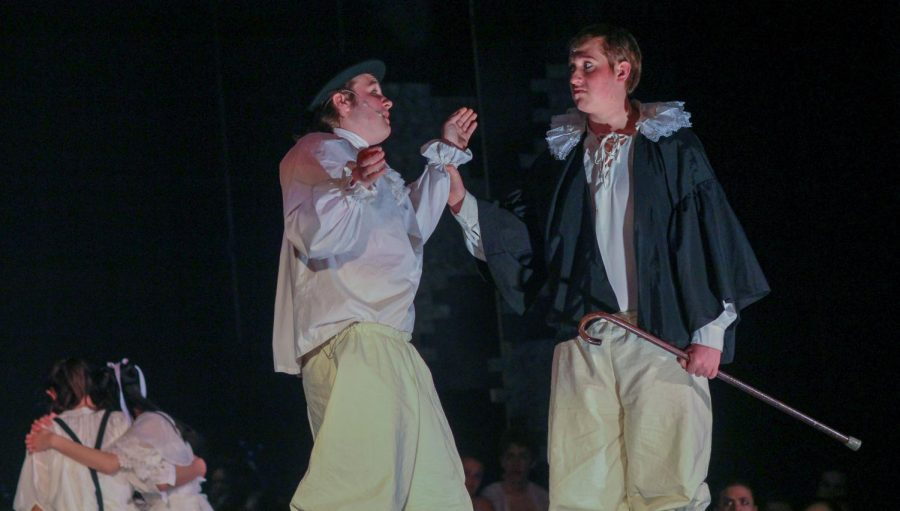 Senior Andrew Green, as the Beadle, attempts to persuade senior Joseph Guenther, as Judge Turpin, into improving his appearance before Turpin proposes to his adopted daughter.