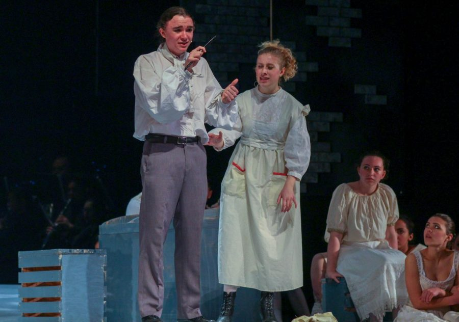 Sweeney Todd, played by junior Ariel Anderson, breaks down as his first attempt to kill Judge Turpin is ruined.  Senior Samantha Rich, as Mrs. Lovett, attempts to soothe his anger.