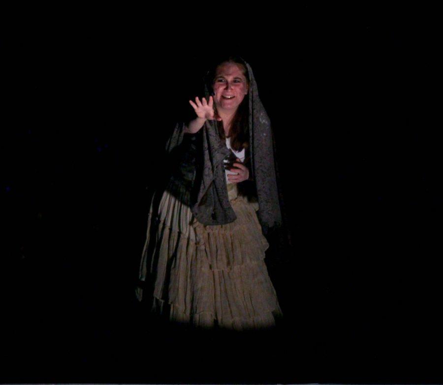 Senior Hailey Mogul, as the Beggar Woman, warns of lurking evil.