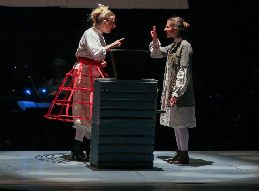 Senior Samantha Rich, as Mrs. Lovett, teaches junior Isabelle Trillin-Lee, playing Tobias Ragg, how to grind meat.