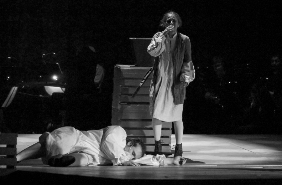 Junior Isabelle Trillin-Lee, as Tobias Ragg, sobs as he stands next to the corpse of senior Andrew Green, playing the Beadle.