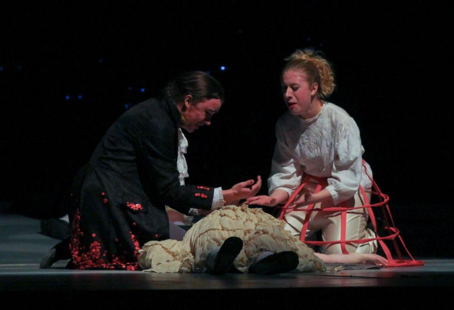 Junior Ariel Anderson, as Sweeney Todd, realizes the beggar woman he killed was his wife. Senior Samantha Rich, as Mrs. Lovett, tries to rationalize why she didnt tell him his wife lived.