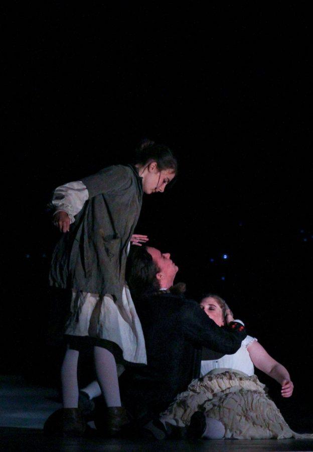 Junior Elisa Jeffries, as Tobias Ragg, kills junior Ariel Anderson, playing Sweeney Todd.