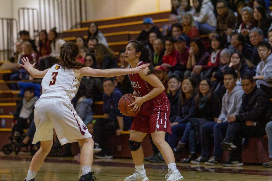 Senior guard Alisa Petalver looks for an open teammate.