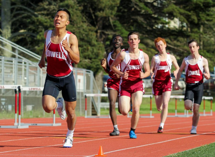 Senior distance runner Henry Lei leads a pack in the 800m.