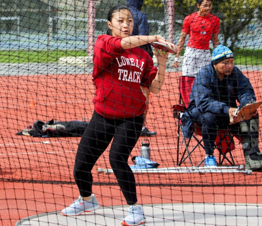 Junior thrower Alexandria Singer gets ready to throw the discus.
