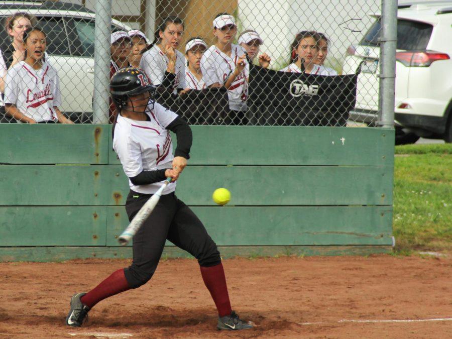 Senior third baseman Emily Jiang swings as her teammates cheer her on.