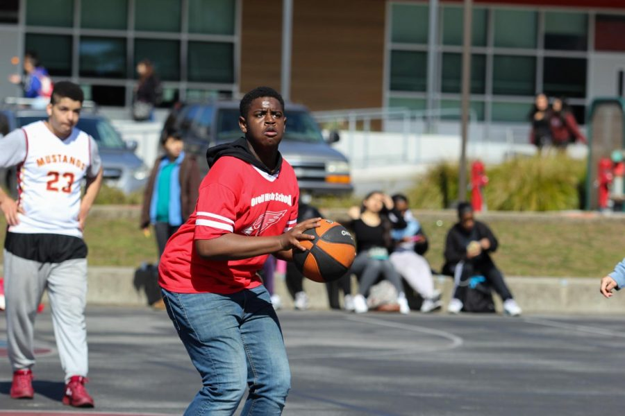 Sophomore Damareya Harrison positions to make a shot during a Special Olympics basketball tournament.