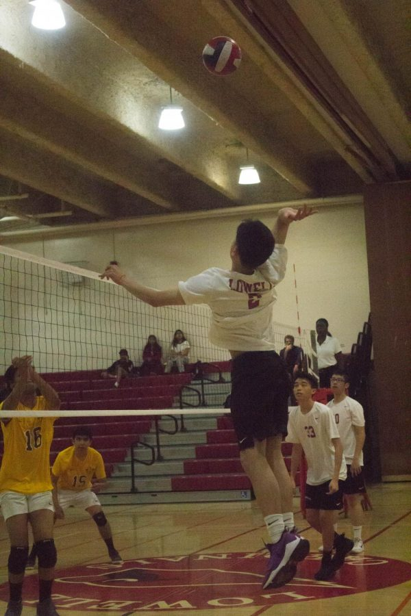Sophomore outside hitter Brandon Bui leaps to take a powerful swing over the net, successfully blocking the Mustangs' attack.