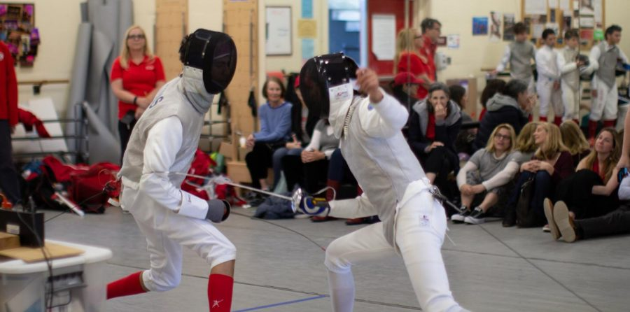 Junior Jonas Castillo lunges at his opponent.