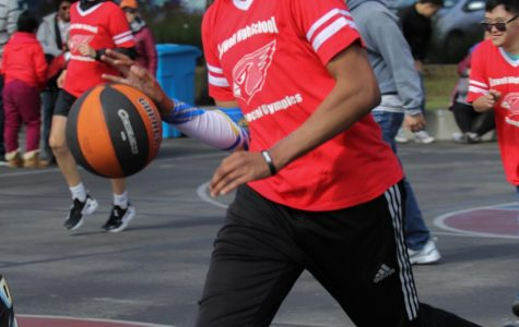 Sophomore Roy Palmer dribbles down the court during a Special Olympics basketball tournament.