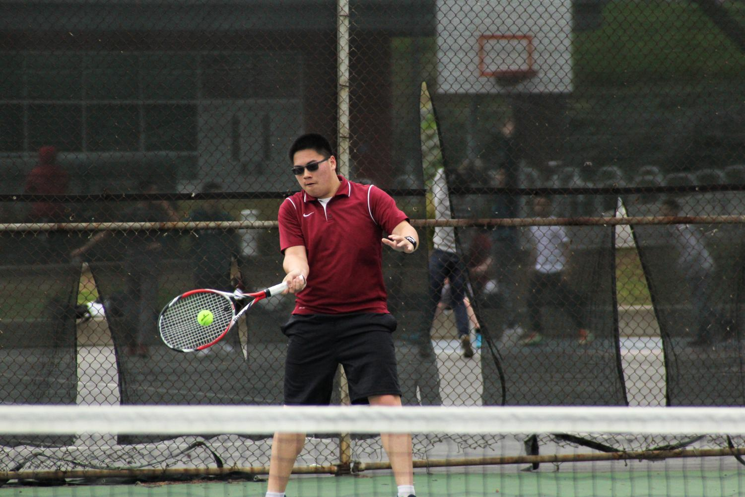 A Cardinal returns a furious shot from the Lincoln Mustangs with a volley during the game on April 3 at home.
