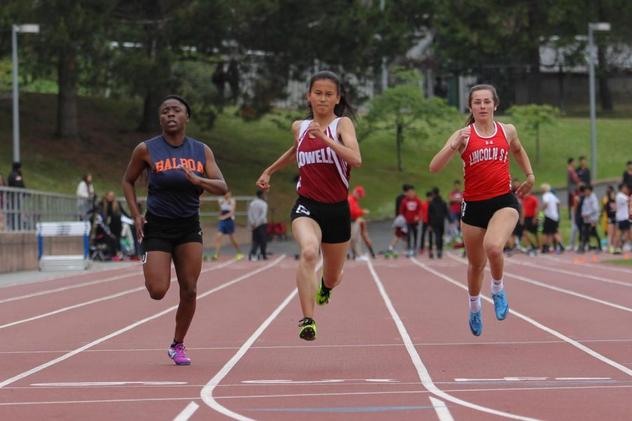 Senior Emily Liu wins first with a time of 12.88 in the varsity girls 100m dash.