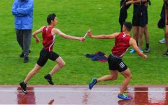 Lowell track reigns through the rain to claim AAA overall team championship