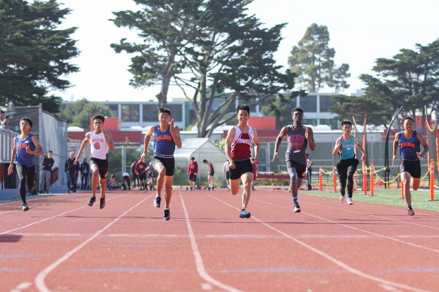 Senior sprinter Jovin Cheung wins the varsity boys 100m dash with a time of 11.16, .15 seconds faster than the next time.