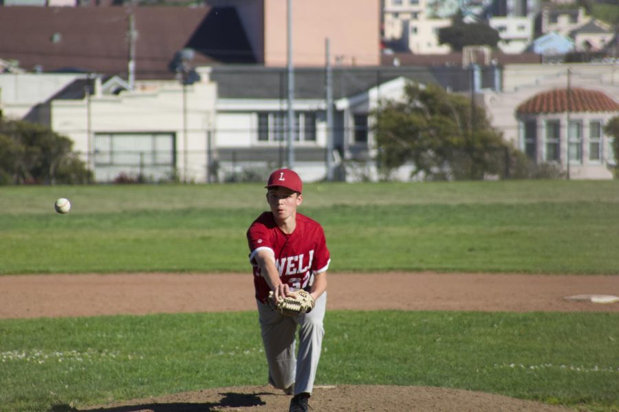 Sophomore pitcher Luke Closson pitches a cut fastball at the mound.