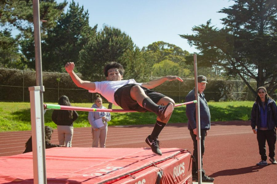 Freshman Andy Truong jumps over the bar in the high jump.