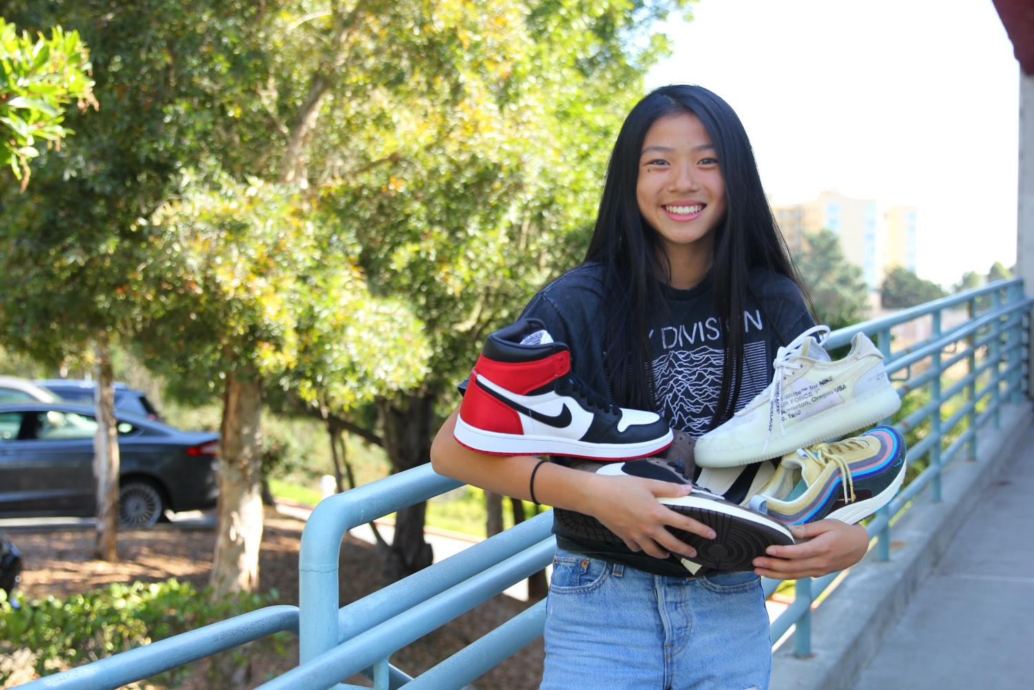 Sophomore Hunter Chan posing with Sneakerhunt shoe inventory