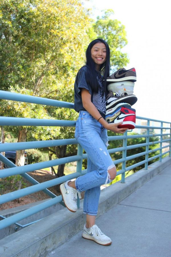 Sophomore Hunter Chan poses with Sneakerhunt shoe inventory