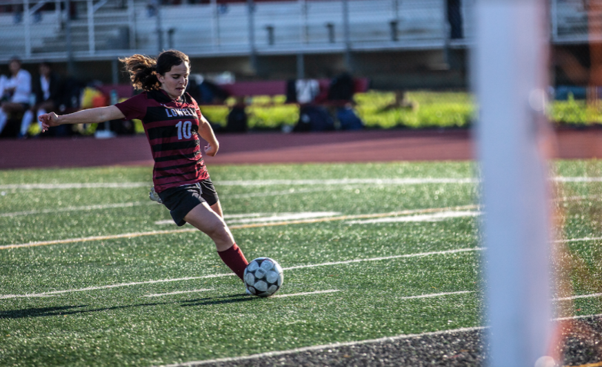 Junior Sarah Ginsburg strikes the ball at the opponent's goal.