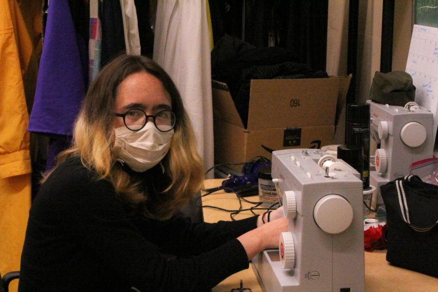 Senior Olivia McAllister, head of the Costume Department, sews the costumes for Lowells production of A Midsummer Night's Dream